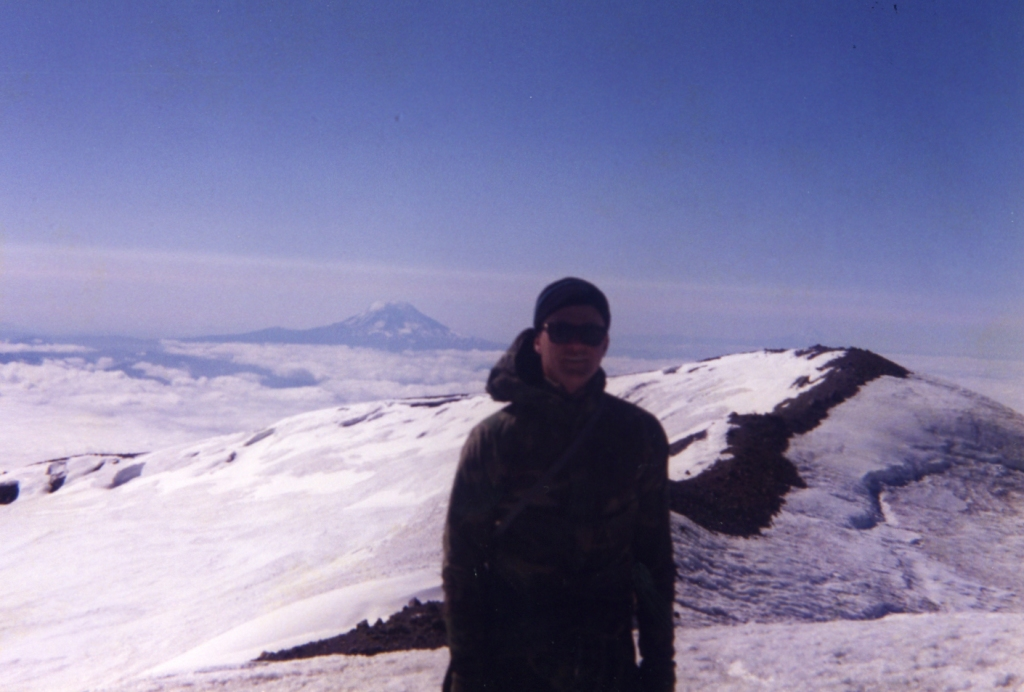 standing at the summit